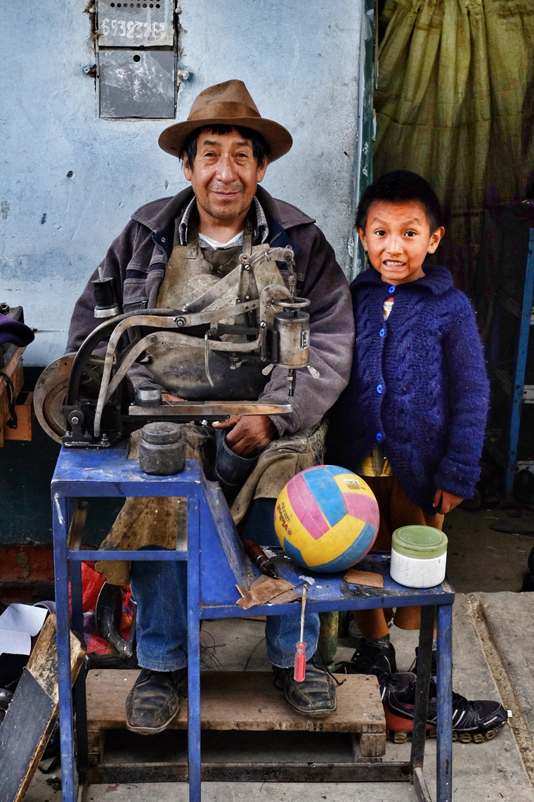 Cobbler and grandson; near Huancayo, Peru