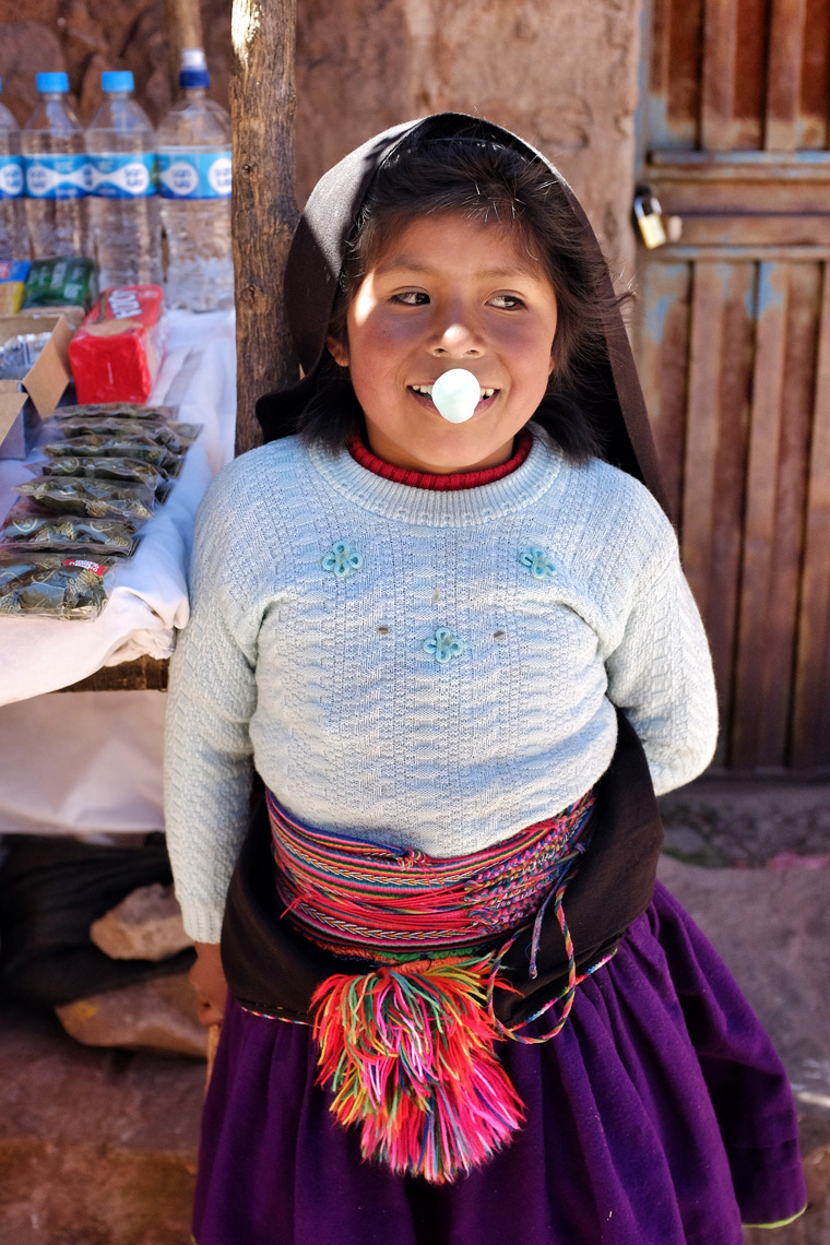 Blowing gum: Taquile Island, Lake Titicaca, Peru