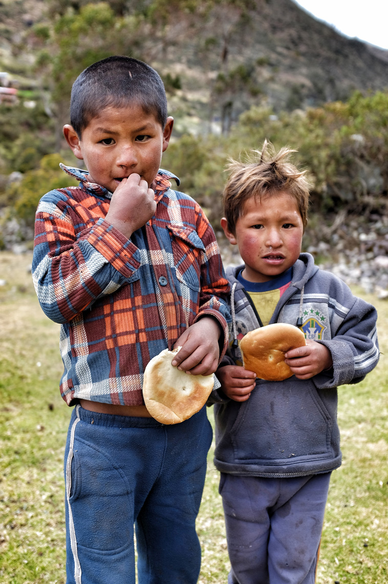 Boys and bread; Lares Valley, Machu Picchu, Peru